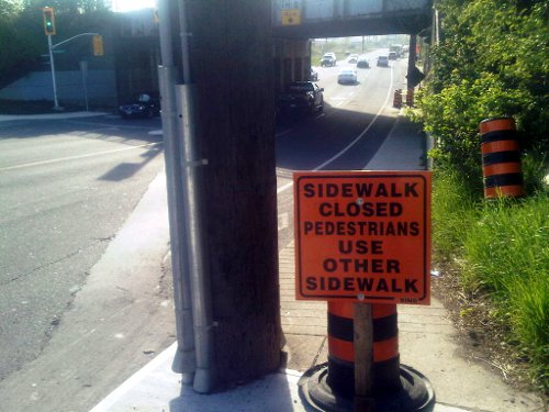 Sidewalk Closed sign on Aberdeen at railroad underpass