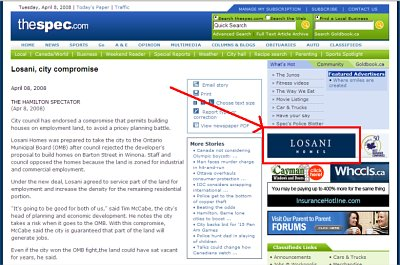 Oops: The Spectator web page on the Losani Homes deal includes an ad for Losani Homes