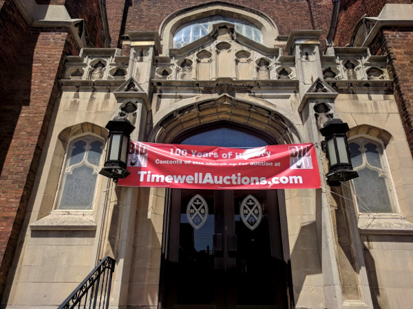 Front door with auction banner (RTH file photo)