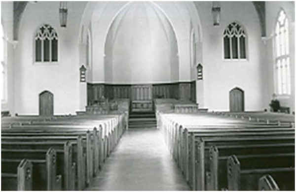 An early photo of the worship space of St John. We are looking south towards King Street