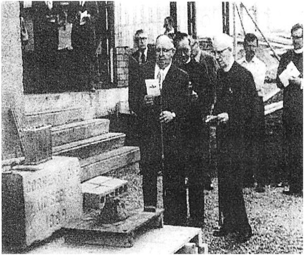 Laying together of the 1889 and 1977 cornerstone. It can still be seen at street level from King William Ave. Clerk of Sessions Gillis McKenzie is holding the dedication reading.