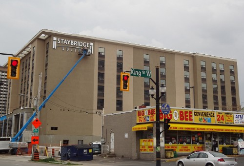 Sign going up on Staybridge Suites Hotel (RTH file photo)