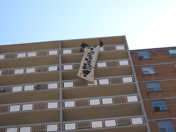 Stoney Creek Towers tenants began their rent strike at the end of April with a rally and banner drop.