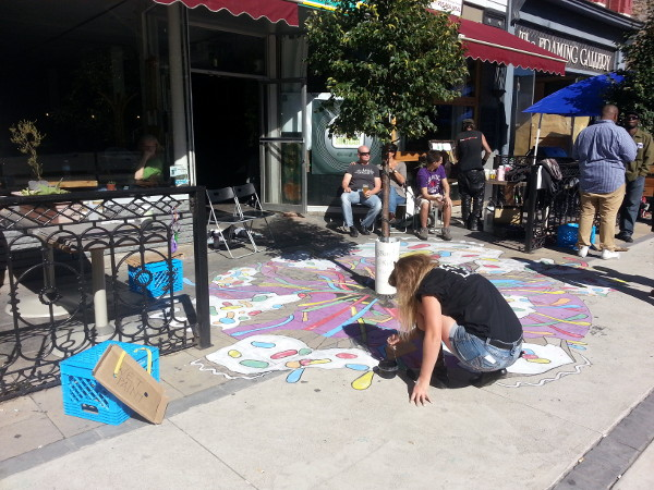 Artist Kiki LeFont painted a sidewalk mural outside Homegrown Hamilton on King William