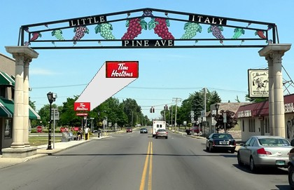 The deep setback and tall sign for this Tim Horton's breaks a Little Italy streetwall in Niagara Falls, NY.