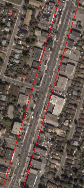 A boulevard on Upper James: the red lines indicate the borders of the boulevard, which would replace parking lots with pedestrian space and stream cars into high-speed through traffic in the centre and low-speed local traffic on the outside. (Image Credit: Google Maps)