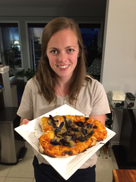 Taryn Aarssen showing off her eggplant pizza