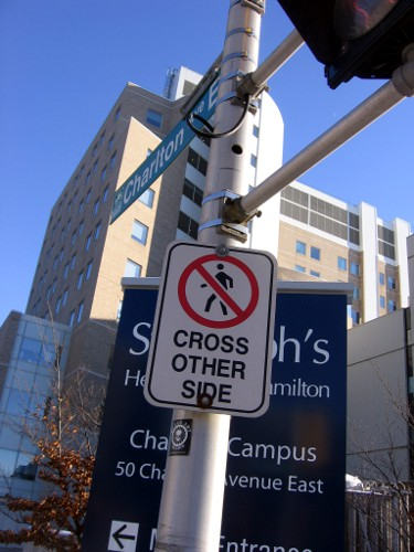 'Pedestrians Cross Other Side' sign on the south side of Charlton at James